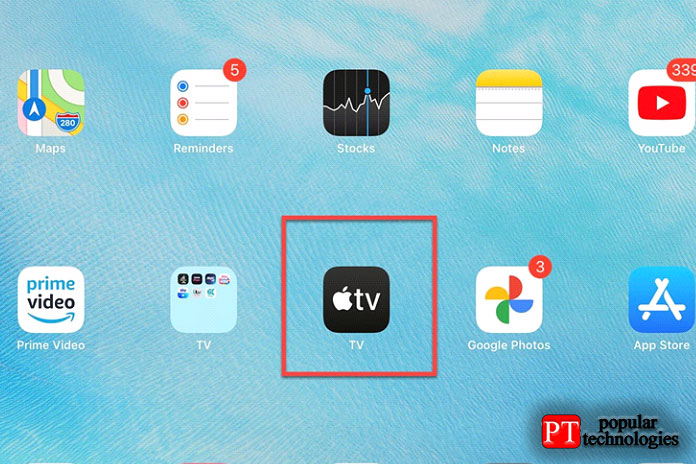 Откройте приложениеTV (указано стрелкой)